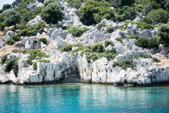 Fragment of sunken city of Kekova from sea. Fragment of ancient sunken city of Kekova view from sea with remains of ancient buildingsp Royalty Free Stock Images