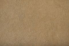 Fragment of the surface of fibrous synthetic non-woven material. Of light brown color. Background, texture Stock Photo