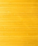 Fragment of surface (wall) of yellow wooden slats arranged horizontally Stock Image