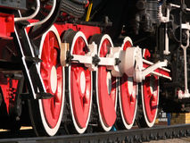 Fragment of system of wheels of a paracart. Five red wheels of impellent system of an ancient steam locomotive Royalty Free Stock Image