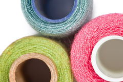 Fragment of three coils with sewing threads Royalty Free Stock Photo