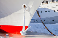 Fragment of a three-deck motor ship with an anchor in the ice stock photography