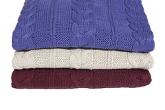 Fragment of three folded sweaters Stock Images