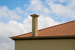 Tiled roof with a pipe Stock Photo