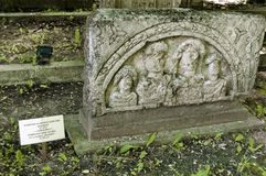 Fragment of tombstone with figures Stock Photos