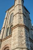 Fragment of the tower of the historic building Royalty Free Stock Image