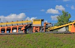 Fragment of track machine on railway mound stock photos