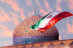 Fragment of traditional Iranian architecture and Iran`s national flag against the backdrop of sunset. Islamic national image.  royalty free stock image