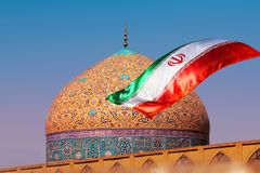 Fragment of traditional Iranian architecture and Iran`s national flag. Islamic national image stock images