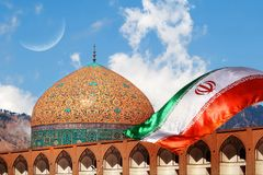Fragment of traditional Iranian architecture and Iran`s national flag. Iranian Islamic national image.  royalty free stock photography