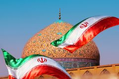 Fragment of traditional Iranian architecture and Iran`s national flag. Islamic national image. Fragment of traditional Iranian architecture and Iran`s national royalty free stock photography