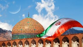 Fragment of traditional Iranian architecture and Iran`s national flag. Iranian Islamic national image.  royalty free stock photo