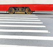 Fragment of the tram moving the crosswalk. Two wheels and a magnetorail brake between them. Background Stock Images