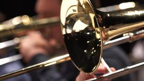 Fragment trumpet closeup. Trumpet player jazz music. Instrument closeup on focus and focusless stock footage