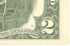 Fragment of two dollars bill. Stock Image
