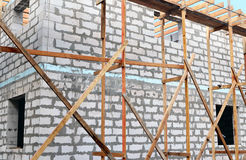 Fragment of  unfinished building with scaffolding Stock Photo