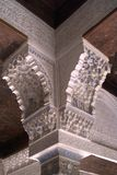 Fragment of the upper part of the column of the Moorish castle. Openwork carving on a stone. Medieval Moorish castle in Spanish Granada. Fragment of the arch and Royalty Free Stock Image