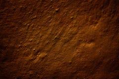 Fragment van de muur, in vurige bruine kleur wordt geschilderd die Stock Foto