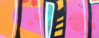 Fragment van een mooi graffitipatroon in roze en groen met stock afbeelding