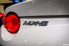 Fragment van een open tweepersoonsauto Mazda mx-5 Stock Afbeeldingen