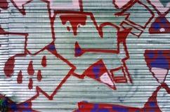 Fragment van een oude muur met het kleurrijke graffiti schilderen royalty-vrije stock fotografie