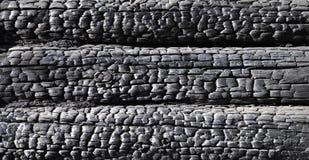 Fragment van gebrande logboekmuur Stock Foto