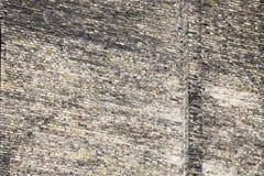 Fragment van grote oude bakstenen muur De textuur van het metselwerk stock foto's