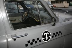 Fragment van retro oude auto Volga GAZ - 21 taxi?en cabine/de USSR 1960 Stock Afbeelding