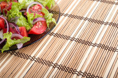 Fragment of vegetarian salad from fresh vegetables on a plate Royalty Free Stock Image