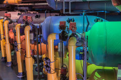 Fragment of view of  many colorful purified water system pipes Royalty Free Stock Photo