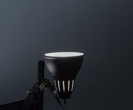 Fragment of view of night lamp in dark room Royalty Free Stock Image