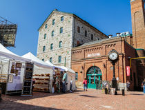 Fragment of view of Toronto distillery historic district square on art fest sunny day. Toronto, Ontario, Canada, May 22, 2016, Toronto distillery historic royalty free stock photography