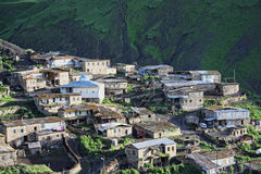 Fragment of village in mountains Stock Photos