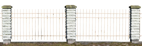 Fragment of a vintage village fence. From the metal pointed rods and the brick white columns. Sunny day. Isolated Stock Photo