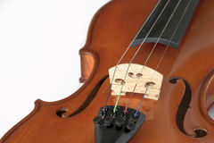 Fragment of violin on white background Stock Photos