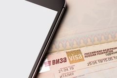 Fragment of a visa of the Russian Federation in the passport. With mobile phone close up royalty free stock photography