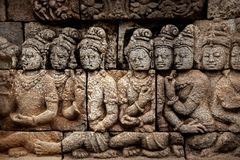 Fragment of wall with ancient bas-reliefs of the Borobudur Temple. Indonesia. Ancient bas reliefs on the walls of the Borobudur temple. Indonesia. Java is an Royalty Free Stock Image
