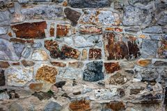 fragment of a wall from chipped stone stock photos