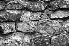 Fragment of a wall from a chipped stone. Gray color Stock Photography