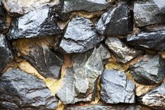 Fragment of a wall from a chipped stone. Gray color Royalty Free Stock Images