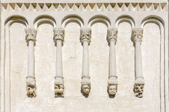 Fragment of wall of church with stone carvings Stock Photos