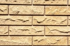 Bricks in the wall. Fragment of the wall, composed of light uneven bricks stock images