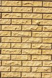 Bricks in the wall. Fragment of the wall, composed of light uneven bricks, vertical shot royalty free stock photo