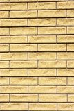 Bricks in the wall. Fragment of the wall, composed of light uneven bricks, vertical shot royalty free stock images
