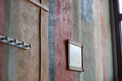 Fragment of wall with different colors stock images