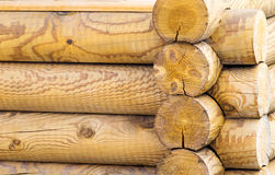 Fragment of the wall executed from round logs. Stock Photos