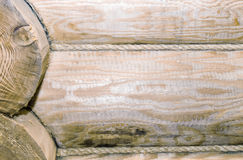 Fragment of the wall executed from round logs. Stock Photography