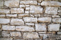 Fragment of wall of large and small stones. Cyprus royalty free stock photography