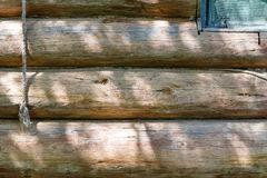 Fragment of the wall of a log rustic home. Natural wood texture Stock Images
