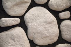 Fragment of wall made of stones stock photos
